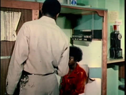 1970s montage teen being photographed for mugshot in police station, los angles, california, usa, audio - foto segnaletica video stock e b–roll