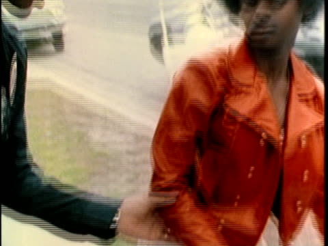 vidéos et rushes de 1970s montage teens getting handcuffed and frisked, los angles, california, usa, audio - arrestation