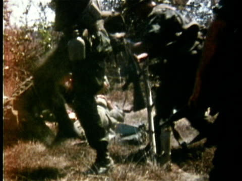 1970s montage us medic-soldiers tending to wounded soldiers on stretchers during the vietnam war / vietnam - vietnam war stock videos & royalty-free footage