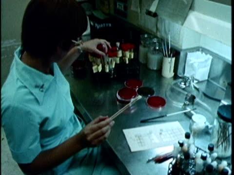 1970s MONTAGE Volunteers working in laboratory, Los Angeles, California, USA, AUDIO