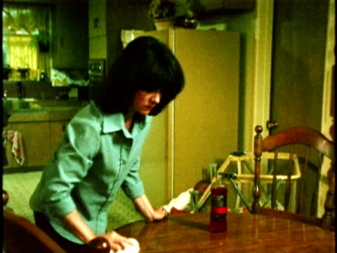 1970s montage woman polishing table is asked by son to settle argument, los angeles, california, usa, audio - babies in a row stock videos & royalty-free footage