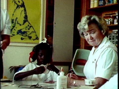 1970s montage young patients playing in doctor's office, los angeles, california, usa, audio - 1970 stock-videos und b-roll-filmmaterial
