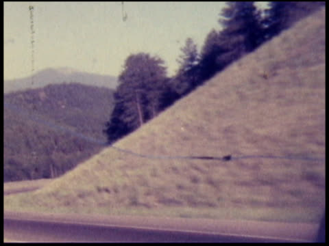 1970s north america: cars on highway between bridges (8mm camera) - car point of view stock videos & royalty-free footage