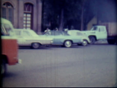 1970s north america: small town people, cars (8mm film camera) - small town stock videos and b-roll footage