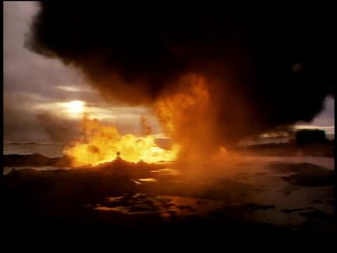 1970s ws oil fire burning / united states - släcka bildbanksvideor och videomaterial från bakom kulisserna