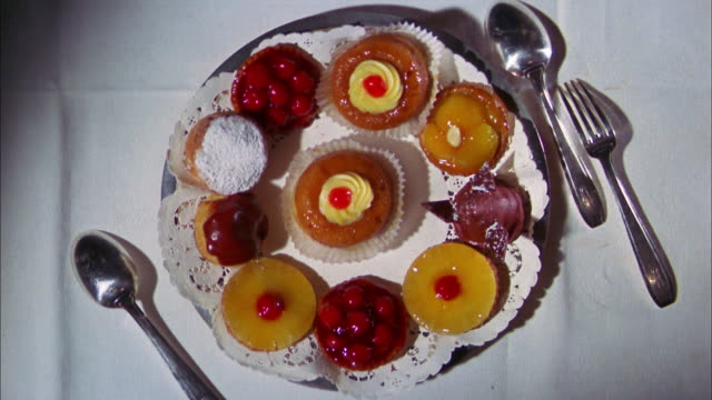 1970s overhead zoom in plate of pastries - sweet food stock videos & royalty-free footage