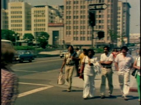 1970s MS Pedestrians crossing street, Los Angeles, California, USA, AUDIO