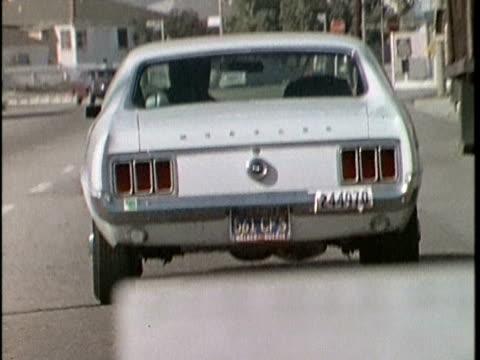 1970s pov police car following suspected car, los angeles, california, usa, audio - suspicion stock videos & royalty-free footage