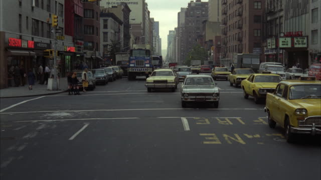 1970s WS REAR POV Driving north with traffic on 3rd avenue / New York City, USA