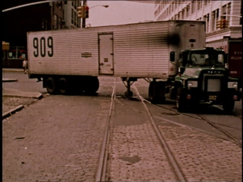 1970s WS Semi-truck driving followed by two cars / Brooklyn, New York, United States
