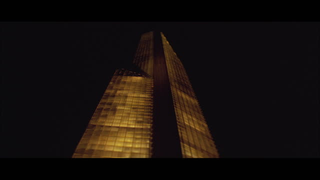 1970s WS LA Skyscraper with lights go on in sections