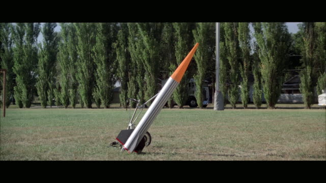 vídeos de stock e filmes b-roll de 1970s ws small rocket fired from football field - 1970 1979