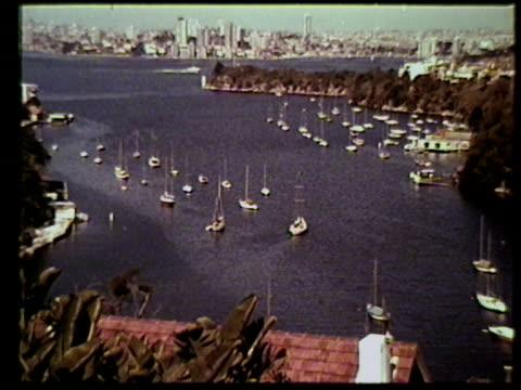 SYDNEY HARBOR VS Red tiled rooftops of houses boats in Sydney Harbor VS Sail boats motor boats cruising in harbor city BG VS Sydney Bridge city...