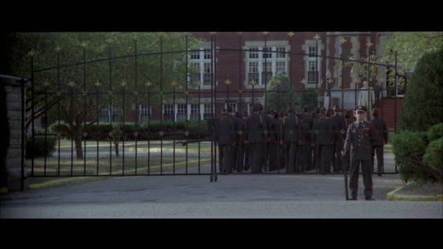1970s ws troops marching behind gate - 1970 1979 stock videos & royalty-free footage