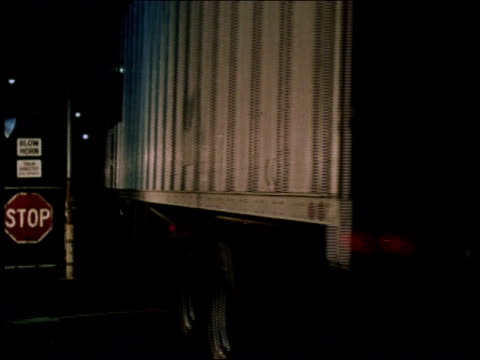 1970s WS Truck pulling into clearly lit gated area / New York, United States