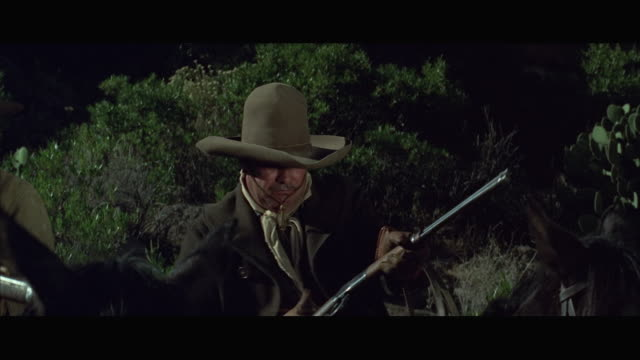 1970s ms pan two cowboys shooting rifles - wild west stock videos & royalty-free footage