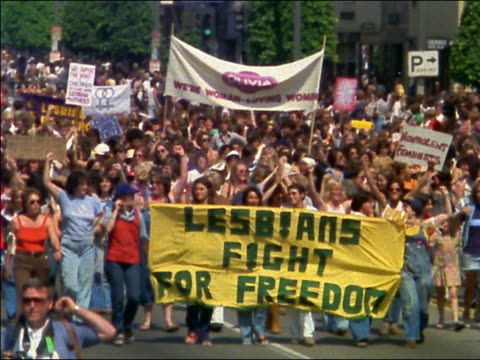 1970s wide shot group of women carrying 'lesbians fight for freedom' banner at protest march - 1970 stock videos & royalty-free footage