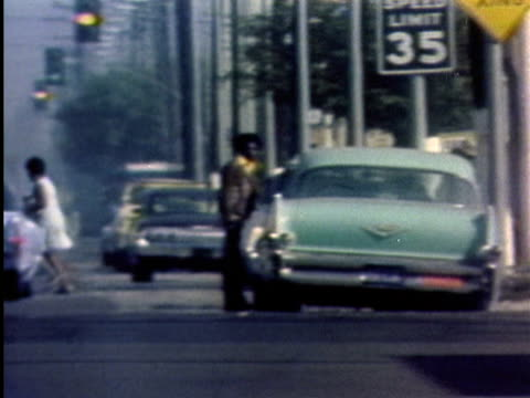 1970s ws pan woman crossing street / los angeles, california / audio - 1975 stock videos & royalty-free footage