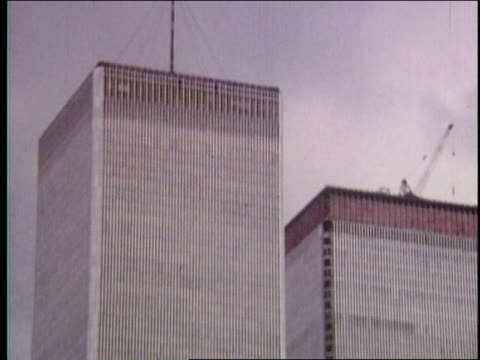 1970s ws world trade center and downtown skyline from hudson river/smiling elderly tourist couple/wtc from new york harbor - 1975 stock videos and b-roll footage