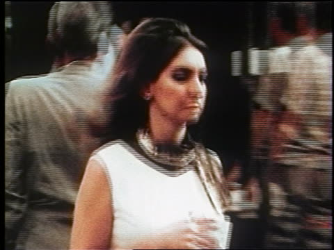 1970s zoom out woman in white dress carrying purse + book crossing nyc street / documentary - purse stock videos & royalty-free footage