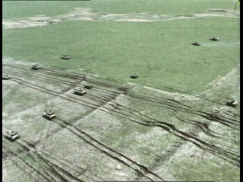 1980s aerial tanks driving across field - medium group of objects stock videos & royalty-free footage