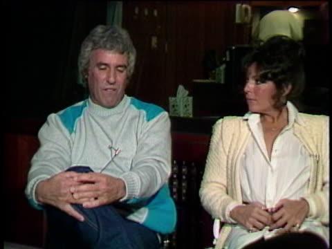 1980s ms zi cu burt bacharach and carole bayer sager being interviewed / los angeles california usa / audio - collegetröja bildbanksvideor och videomaterial från bakom kulisserna