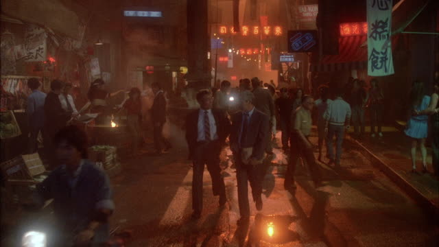 1980s ws ds busy chinatown street - chinatown stock videos and b-roll footage