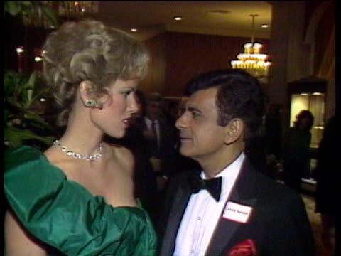 vidéos et rushes de 1980s ms celebrities at premiere casey kasem kissing wife / los angeles california usa - cérémonie