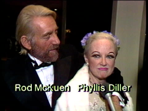 1980s celebrities at premiere, rod mckuen and phyllis diller being interviewed / los angeles, california, usa / audio - フィリス ディラー点の映像素材/bロール