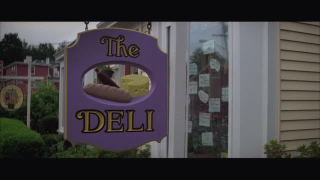 stockvideo's en b-roll-footage met 1980s cu delicatessen sign - westers schrift
