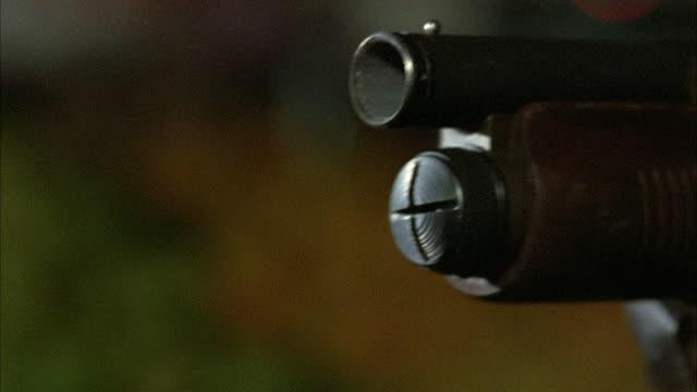 stockvideo's en b-roll-footage met 1980s ecu end of rifle barrel firing - jachtgeweer