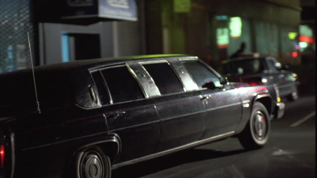 1980s ws td exterior of recording studio with black limousine pulling away - limousine stock videos & royalty-free footage
