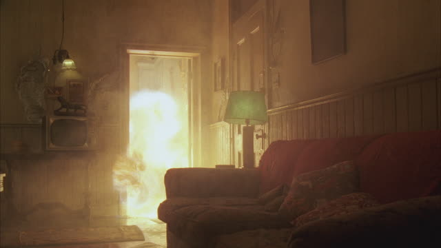 vídeos de stock e filmes b-roll de 1980s ws fire exploding and bursting into hotel room - fogo