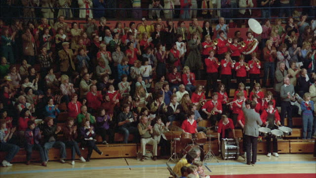 1980s WS High school gymnasium wrestling match, crowd and band.
