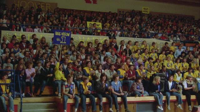 1980s WS ZI High school gymnasium wrestling match, crowd reaction.