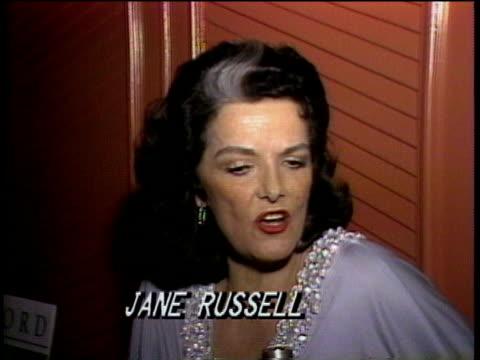 vídeos de stock, filmes e b-roll de 1980s ms jane russell being interviewed / los angeles california usa / audio - só uma mulher idosa