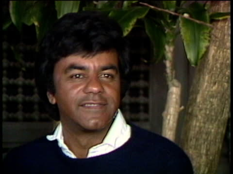1980s CU Johnny Mathis being interviewed / Los Angeles California USA / AUDIO