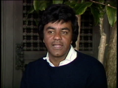 1980s MS ZI ZO Johnny Mathis being interviewed / Los Angeles California USA / AUDIO