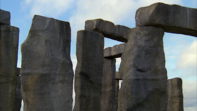 1980s ms pan large stone slab falling over / london, uk - block shape stock videos & royalty-free footage