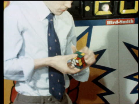 part 1 112903 cube julian chilver 15 year old schoolboy from norwich has broken the world speed record for solving the rubik cube cube being... - 1980 stock videos & royalty-free footage