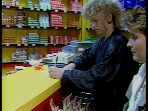 part 3 t16098802 1691988 continues london dixons shop interior customer with credit card signing credit slip for sale signs estate agents exterior... - collection stock videos and b-roll footage