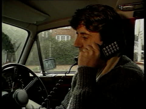1980s lifestyle collection: part 3; t17018915: 17.1.1989 tom conti not happy with his carphone: actor conti driving along in his rolls-royce; conti... - tom conti stock videos & royalty-free footage