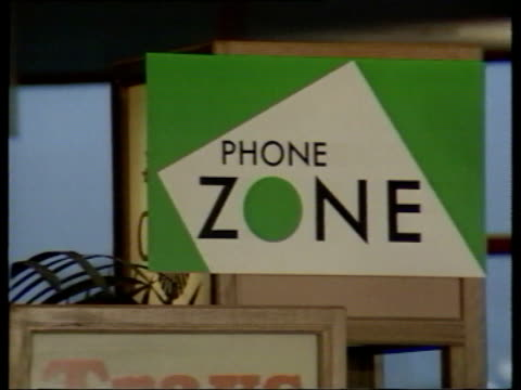 part 3 T26018910 2611989 TELEPOINTS man using phone in motorway service station base point of phone zone base point of phone zone interview John...