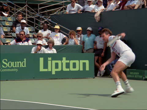 1980s medium shot Jimmy Connors playing in match on tennis court / Miami