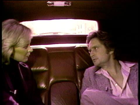 stockvideo's en b-roll-footage met 1980s ms zi cu michael douglas being interviewed in limousine / los angeles california usa / audio - passagiersstoel