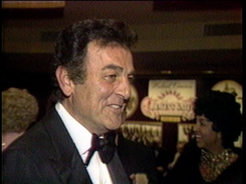 1980s montage celebrities at premiere, including ernest borgnine / los angeles, california, usa - film premiere stock videos & royalty-free footage