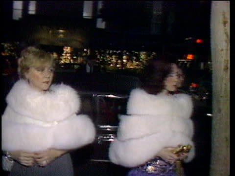 1980s montage celebrities getting out of limousine and being interviewed / los angeles california usa - limousine luxuswagen stock-videos und b-roll-filmmaterial