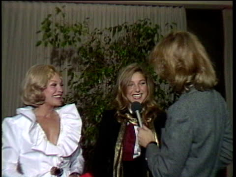 1980s MONTAGE Joanna Cook Moore and Tatum O'Neal being interviewed / Los Angeles California USA / AUDIO