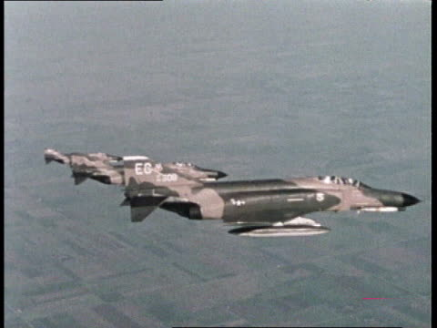 1980s montage usaf fighters flying in formation / united states - us air force stock videos & royalty-free footage