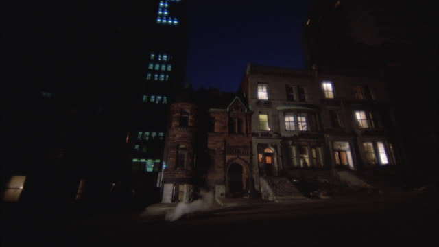 1980s WS LA Older three story brownstone apartment building illuminated at night